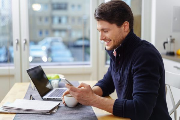 Attractive business man working from home