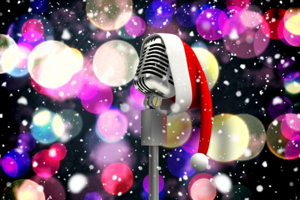 Composite image of microphone with santa hat against twinkling yellow and purple lights