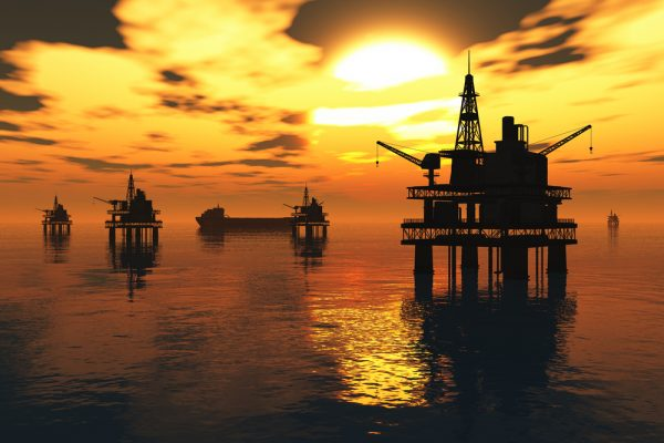 Oil Field Pumps Silhouettes in the Sunset 3D render