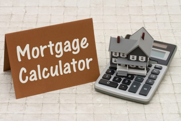 Home Mortgage Calculator, A gray house, brown card and calculato