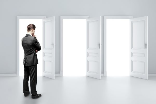 man choosing door