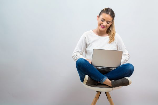 Young woman with a laptop computer
