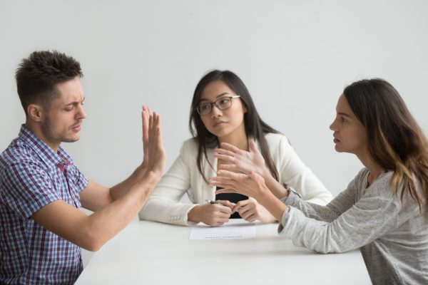 Unhappy married couple getting divorced arguing fighting in lawy