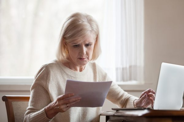 Serious,Frustrated,Middle,Aged,Senior,Woman,Worried,Reading,Bad,News